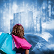 Girl with shopping bags looking at data server on top of earth — Stock Photo #25733979