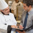 Stock Photo: Waiter and chef discussing menu