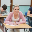 Writing students in a classroom — Stock Photo