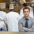 Waiter standing in the kitchen — Stock Photo