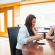 Stock Photo: Two womsitting in cafeteriand drinking coffee