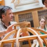 Explaining teacher in a woodwork class — Stock Photo #25734371