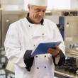 Chef using his digital tablet — Stock Photo