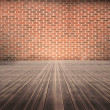 Room of floorboards with bricks wall — Stock Photo