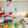 Couple reading cookbook — Stock Photo