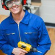 Stock Photo: Student standing while holding a driller