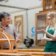 Students and teacher talking and laughing in woodwork class — Stock Photo #25735169