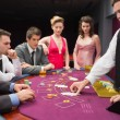Looking at dealer dealing blackjack cards — Stok fotoğraf