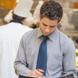 Waiter looking at folder — Stock Photo