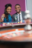 Couple sitting at roulette table — Stock Photo