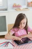 Young girl using a tablet computer — Stock Photo