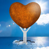 White human representation holding a big brown heart — Stock Photo