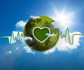 Green and white waveform with green earth and heart shape — Stock Photo