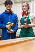 Two woodworking students standing before a workbench — Stock Photo