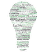 Various green words forming a light bulb — Stock Photo