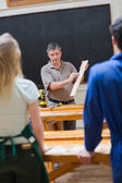 Explaining teacher and the woodwork class — Stock Photo
