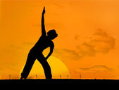 Calm silhouette of woman practicing yoga — Stock Photo