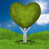 Human representation holding a big green heart — Stock Photo