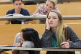 Demotivated students in a lecture hall — Stock Photo