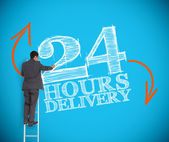 Businessman writing 24 hours delivery — Stock Photo