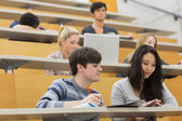 Working students sitting in a lecture hall — Stock Photo