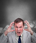 Hot headed business man shouting — Stock Photo