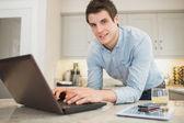 Man typing at the laptop — Stock Photo