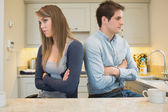 Divided couple with arms crossed — Stock Photo