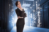 Businesswoman contemplating in data center — Stockfoto