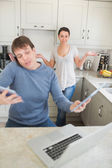 Man busy with technology while his wife wondering why — Stock Photo