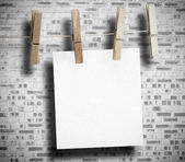 White paper hung with clothespin — Stock Photo