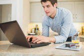Enthusiastic man surfing the internet — Stock Photo
