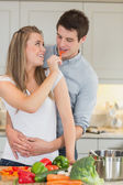 Woman having fun by feeding man — Stock Photo