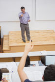 Students having a lesson in the lecture hall — Stock Photo