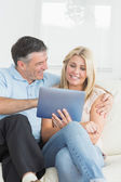 Wife and husband using tablet pc together — Stock Photo