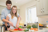Man and woman cooking — Stock Photo