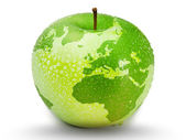 Green apple representing earth with drops on it — Stock Photo