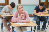 Thoughtful students studying in a classroom — Stock Photo