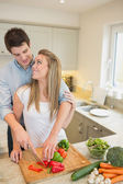 Couple working in the kitchen together — Stock Photo