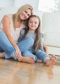 Smiling mother and daughter embracing — Stock Photo