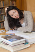 Stressed student in a library — Stock Photo