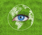Blue eye surrounded by a drawing of the Earth — Stock Photo