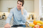 Man calling in the kitchen — Stock Photo