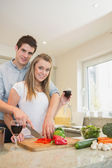 Couple chopping peppers and drinking wine — Stock Photo