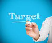 Businesswoman writing target with a chalk — Stock Photo