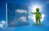 Yeşil karakter bir jigsaw sunulması — Stok fotoğraf