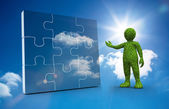 Green character presenting a jigsaw — Stock Photo