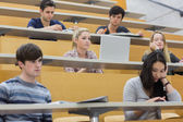 Class listening in a lecture hall — Stock Photo