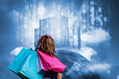Girl with shopping bags looking at data server on top of earth — Stock Photo
