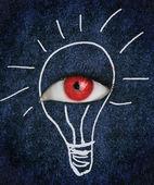 Červených očí nad modré textury, obklopený kresbou žárovka — Stock fotografie
